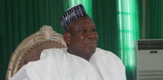 Governor Abdullahi Umar Ganduje appears with a cap other than red (and white) in public function for the first time in 7 years.