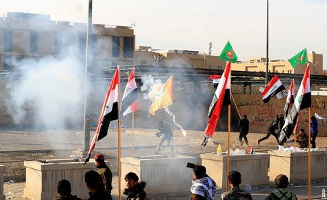 United States, Iraqi forces fire tear gas to protesters at Baghdad's U.S. embassy