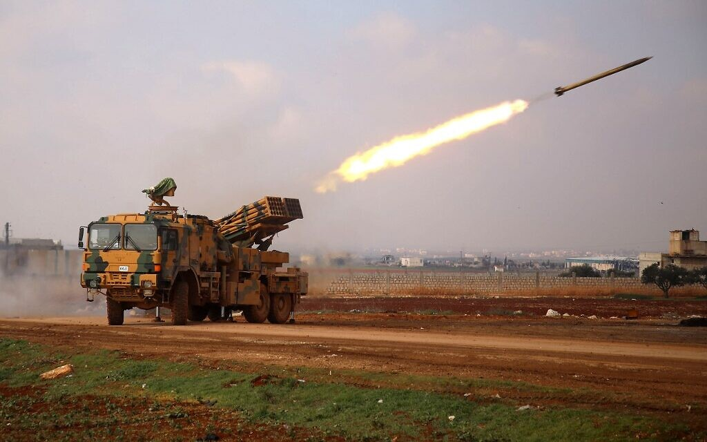 A Turkish military mobile rocket launcher fires from a position near the village of Miznaz, on the western outskirts of Syria's Aleppo province, on February 14, 2020, at Syrian government forces' positions in the countryside of Aleppo province. (Photo by AAREF WATAD / AFP)