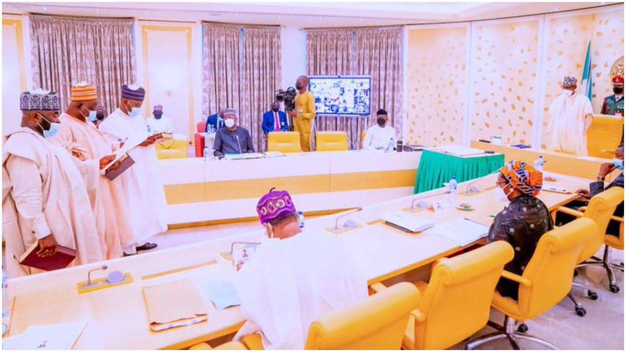 Buhari swears in 2 INEC Commissioners
